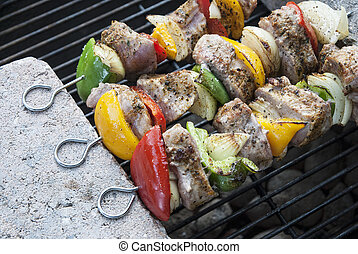 BBQ with kebab cooking coal grill of lamb meat skewers