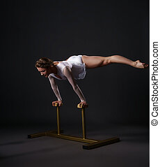 Beautiful acrobat training on circus stands