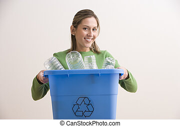 Attractive Young Woman Holding a Blue Recycle Bin