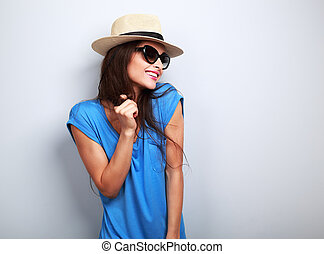 Happy enjoyment young woman in sun glasses and hat posing on...