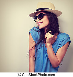 Happy enjoyment young woman in sun glasses and hat posing....