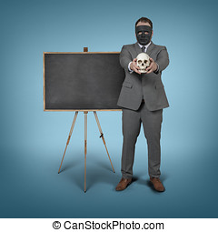 Blank blackboard with businessman holding skull at office
