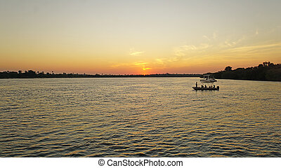 Sunset in Africa - Sunset on the Zambezi River in Zambia,...