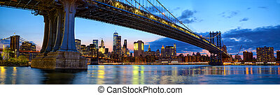 Manhattan Bridge panorama with skyline and Brooklyn Bridge...