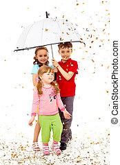 Joy - Portrait of smart children under umbrella over...