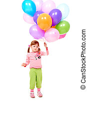 Celebration - Image of small girl with helium balloons at...