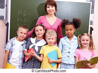 Successful group - Line of cute schoolchildren looking at...