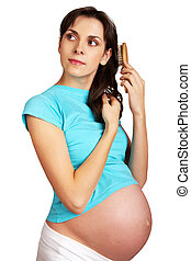 Brushing hair - Photo of pretty pregnant woman brushing her...