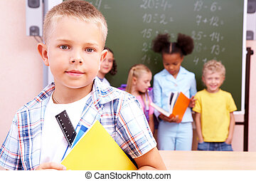 Smart boy - Image of smart schoolboy looking at camera with...