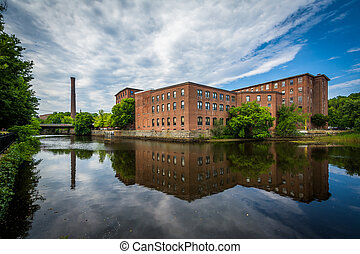 Historic brick buildings and the Cocheco River, in Dover,...