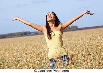 Surrender - Image of joyful girl with stretched arms...