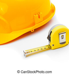 Construction helmet with measure tape on white - Yellow...