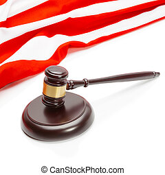 Wooden judge gavel near flag of Unites States of America -...