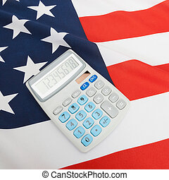 National flag with calculator over it - USA - Part of...
