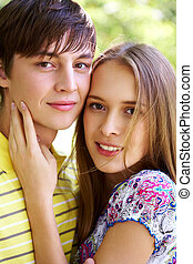 Dates - Portrait of smiling girl and her boyfriend looking...
