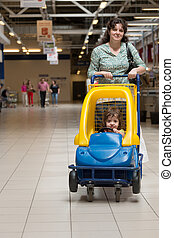 woman with child in a supermarket