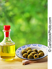 plate of olives and oliveoil
