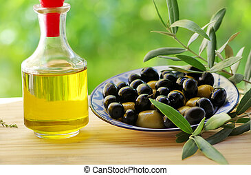 olives on plate and oliveoil