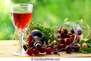 Rose wine and red cherries