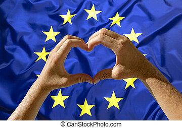 Hands heart symbol, European Union flag - Female hands heart...