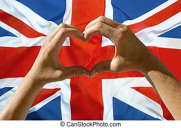 Hands heart symbol, UK flag - Female hands heart symbol with...
