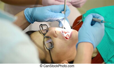 Dentist Conducting An Operation In Mouth, Close Up