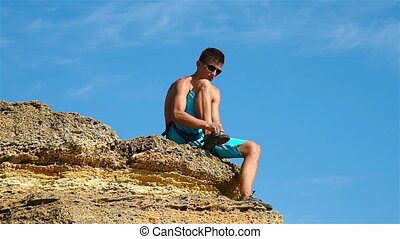 Climber Puts Shoes - Extreme Climber Puts Shoes Sitting On A...