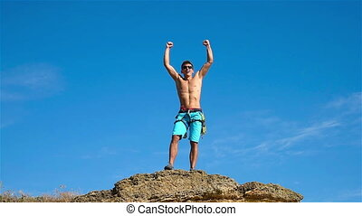 Climber Raising Hands - Extreme Climber Raising Hands On The...