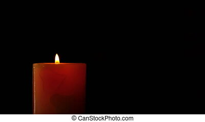 footage burning candle isolated on black 4K video