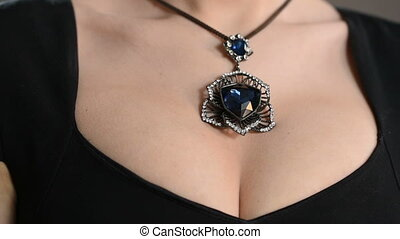 necklace on the neck. breast closeup - necklace on the neck....