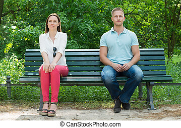 images photos de jeune couple assis banc jardin 21 photos et images libres de droits de jeune. Black Bedroom Furniture Sets. Home Design Ideas
