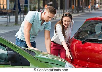 Woman Showing Man Car Collision - Young Woman Showing Man...