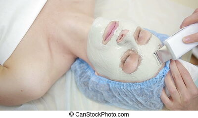 face of women getting a spa treatment deep facial cleansing...