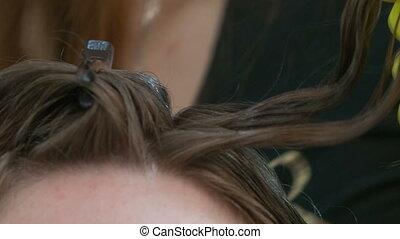 Keratin hair straightening at home. - Two girls make keratin...