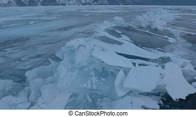 Large blocks of ice crack near Holy Nose Peninsula....
