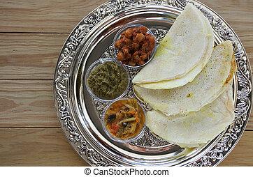 Flat lay of Indian food, Masala Dosa with Sambar and Channa...
