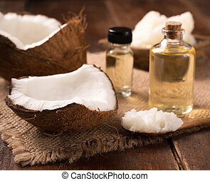 coconut oil and cosmetic cream on wooden background