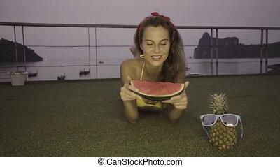 Woman in bikini eating watermelon - Happy young woman...