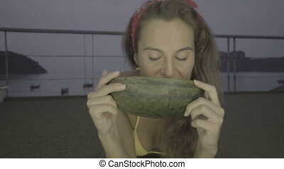Woman in bikini eating watermelon - Happy young woman...