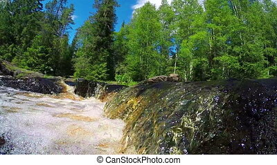 River waterfall slow motion in Karelia, Russia
