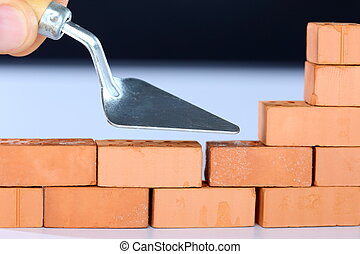 build up a brick wall - to build up a brick wall with tool