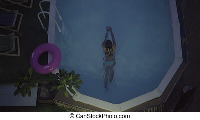 Woman relaxing at the luxury pool