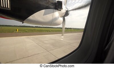 Take off into the sky commercial screw aircraft. View from...