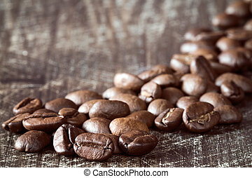 Heap of coffee beans close-up.