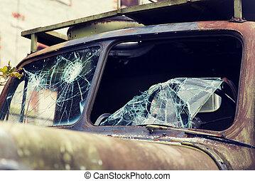 war truck with broken windshield glass outdoors - wartime,...