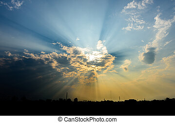 sun rays are striking through the clouds