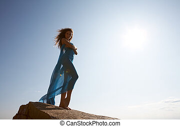 Goddess - Photo of graceful female folded in dark blue...