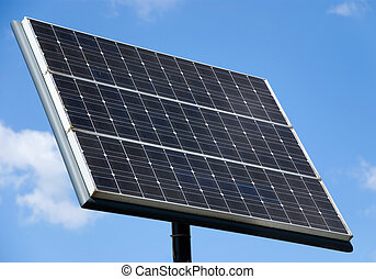 solar panel in front of blue sky