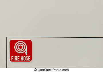 Fire hose symbol on the wall