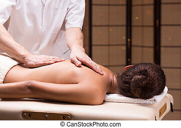 The best cure for back pain - Attractive woman lying during...